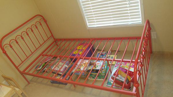 Red twin iron bed no mattress