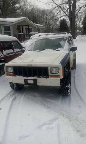 I have a 1999 Jeep Cherokee four by four runs and drives great four by four works great looking to trade for Sale in Montague, MI