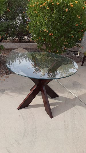 Small glass kitchen table with dark brown wooden pedestal. 42 inches in diameter. In great shape. 30 inches in height. for Sale in Avondale, AZ