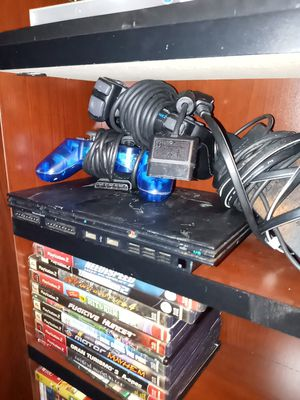 Playstation 2 with 2 controllers and 12 games for Sale in Monroe, NC