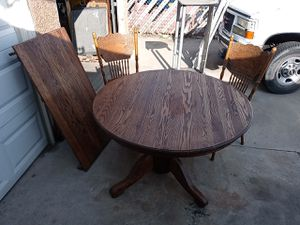 Four chairs and table for Sale in Bakersfield, CA