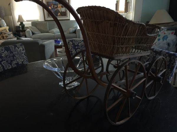 Antique doll carriage , wood wheels, very old $75.