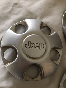 Jeep wheel center caps (4) for Sale in Lacey Township,  NJ