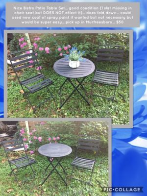 Nice Bistro Patio Table Set... good condition (1 slat missing in chair seat but DOES NOT affect it)... does fold down... could used new coat of spray for Sale in Murfreesboro, TN