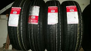 Set of new trailer tires St 205/75/15 mounted & balanced for Sale in St. Louis, MO