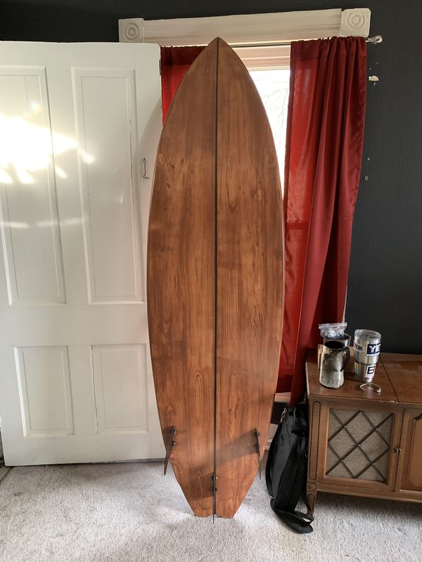Surfboard with wood work done to it