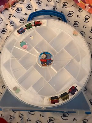 I have a Thomas and friends minis carrying case holds about 16 minis for Sale in Austin, TX
