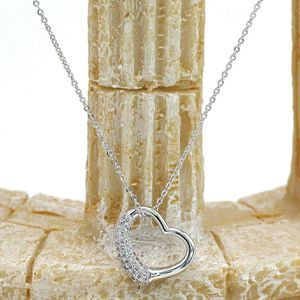 Silver cabinet micro crystal heart necklae for Sale in Redwood City, CA