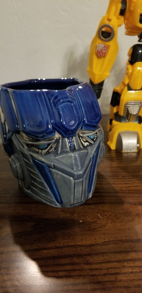 Bumble Bee toy and Optimus Prime ceramic mug- Universal Studios 2012 collectable