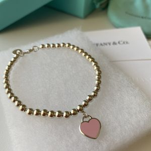 BRAND NEW Authentic Tiffany Pink Heart Tag Bead Bracelet for Sale in Pompano Beach, FL