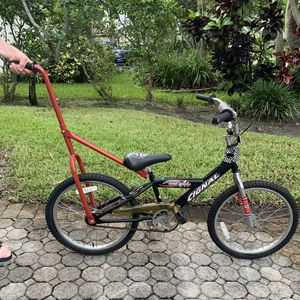 Kids Red bicycle with training stick for Sale in Pembroke Park, FL