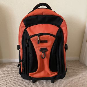Orange Backpack Travel Bag with Roller for Sale in Las Vegas, NV