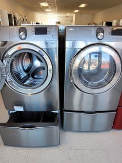 Samsung Front Load Washer And Electric Dryer Set With Pedestal Used In Good Condition With 90day's Warranty for Sale in Mount Rainier,  MD