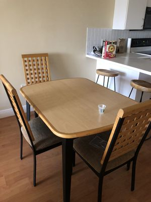 Table with three chairs for Sale in North Miami, FL