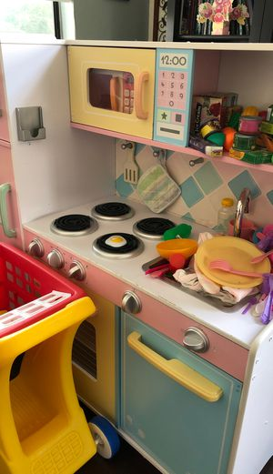 Little kids play kitchen with toy food and a shopping cart for Sale in Vacaville, CA