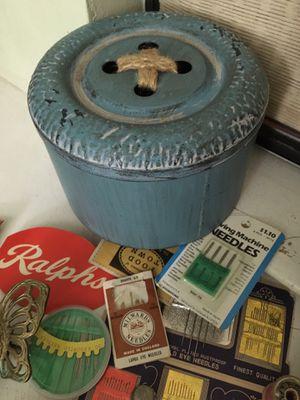 Lots of sewing items brass butterfly pin cushion button metal sewing tin vintage wooden spools, lots and lots of buttons vintage cloth tape measure a for Sale in Dallas, TX