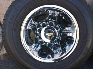 Four chrome Chevy 17 inch dually rims and tires. 8 on 210mm, 2011 up for Sale in Commerce, CA