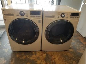 Lg front loads steam washer and steam dryer electric for Sale in Houston, TX