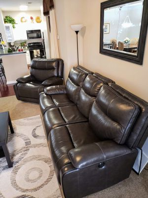 Black leather reclining sofa with power headrest and lumbar support for Sale in Dunwoody, GA