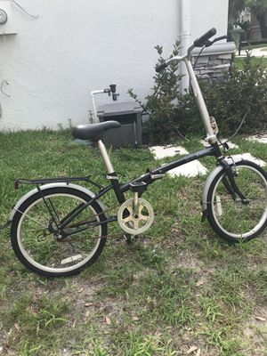 Black folding bike 20 inch wheels Dahon Single speed $200 for Sale in Tampa, FL
