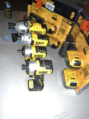 Brand new dewalt brushless xr 7/16- 1/2 - 3/8-1/4 impacts 4- 5ah batteries 2 chargers 2 tool bags Christmas 🎄 special for Sale in Plant City, FL