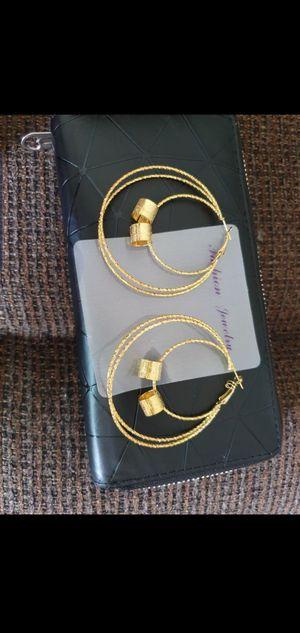 Woman hoop earrings for Sale in Ruskin, FL