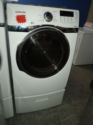 SAMSUNG ELECTRIC DRYER WITH PEDESTAL WORKING PERFECT W/4 MONTHS WARRANTY for Sale in Baltimore, MD