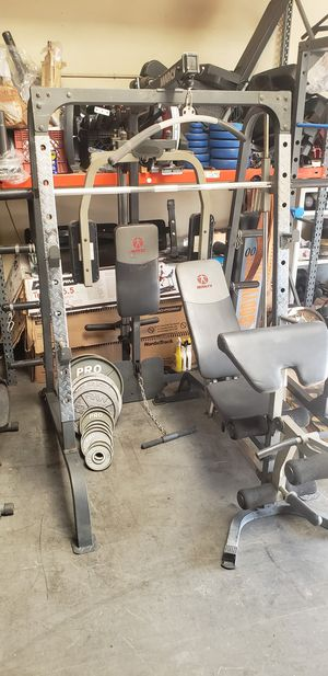 Marcy Smith Machine with Olympic weights for Sale in Garden Grove, CA