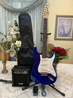 blue huntington guitar package with amp steel cable case and guitar picks for Sale in Cudahy, CA