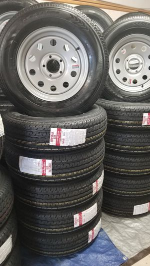 NEW TRAILER TIRES AND WHEELS 205 75 15 (8 PLY HEAVY DUTY)ON 5 LUG SILVER BULLET WHEELS for Sale in Douglasville, GA