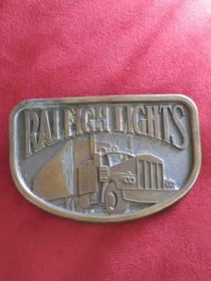 COLLECTIBLES..LOOK!! Vintage Raleight Lights Belt Buckle.has a scratch see last picture for Sale in Lincoln Acres, CA