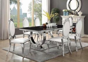 Bring glamour to your dining room with the beautiful Antoine five-piece dining set. It comes in a gorgeous silver finish and the table features a rec for Sale in Chino, CA