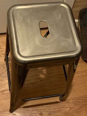 Stackable silver glossy buffed metal bar stool w/slightly bent foot for Sale in Bellevue, WA