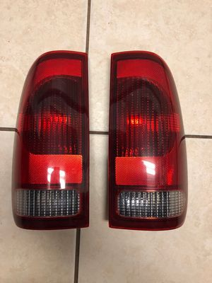 2006 F350 Rear Taillights/Front Wheel Center Caps (OEM) for Sale in Palmetto, FL
