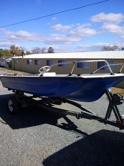 14ft center console with galvanized roller trailer for Sale in Martinsburg,  WV