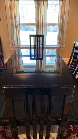 Elegant, black table with 6 chairs! Slight damage to one chair as shown in picture. You must be willing to pick up. for Sale in Auburn, WA