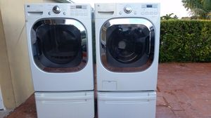 LG STEAM WASHER AND ELECTRIC STEAM DRYER SUPERCAPACITY WITH PEDESTALS for Sale in Hialeah, FL
