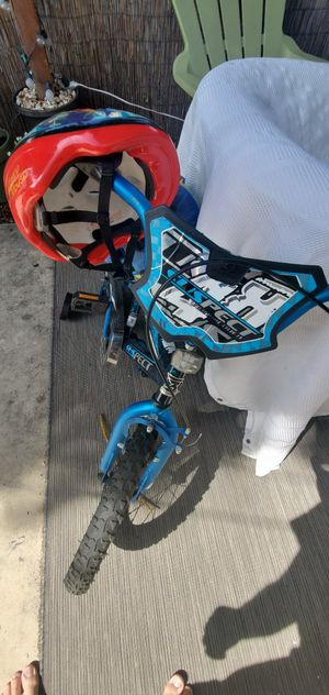 Kids bike with training wheels and 2 helmets for Sale in Los Angeles, CA