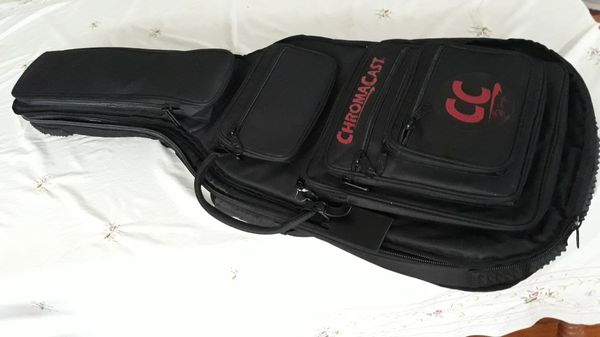 Electric guitar bag, 37 inch interior height and 41 inch exterior height. Several pockets for cd's, notebook, or tablets, cable and guitar support.