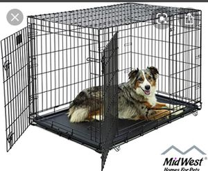 Double door folding metal dog crate for Sale in New York, NY
