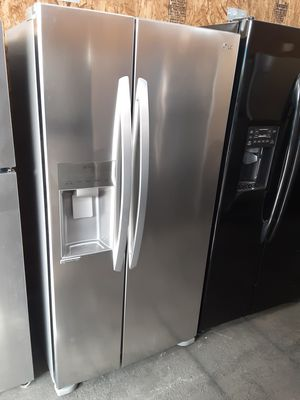 $699 LG stainless side-by-side fridge measures 33 wide 2016 model includes delivery in the San Fernando Valley a warranty and installation for Sale in Los Angeles, CA