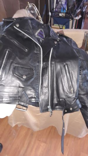 Leather motorcycle Jack. Never worn. Still stiff. Have totally mink oiled 4 times. Ladies jacket size 10. Brand new never worn for Sale in DeBary, FL