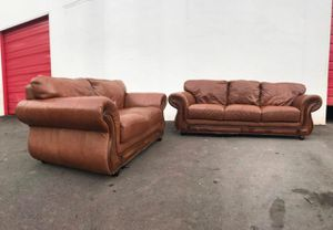 Solid wood and genuine leather sofa and love seat in very good conditions. Clean well kept for Sale in Charlotte, NC