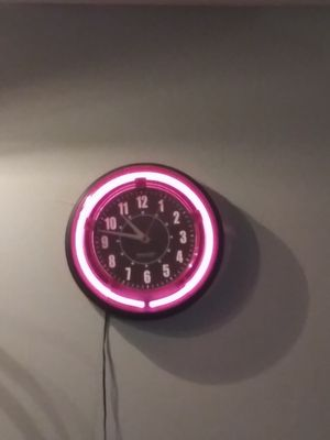 Pink neon wall clock for Sale in Clarksville, IN