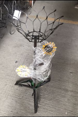 One Metal Flower Style Planter With Flowerpot for Sale in Austin, TX