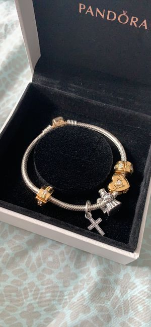 Pandora two toned bracelet 14 k gold/ w charms for Sale in Alexandria, VA