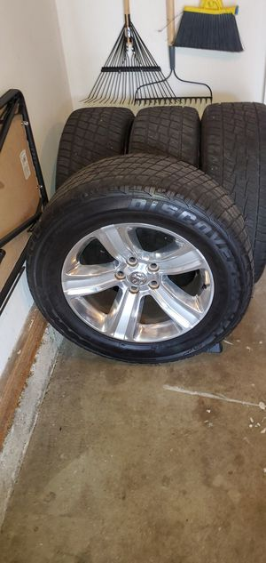 2016 Dodge Ram 1500 Rims and Tires with lug nuts for Sale in Medford, OR