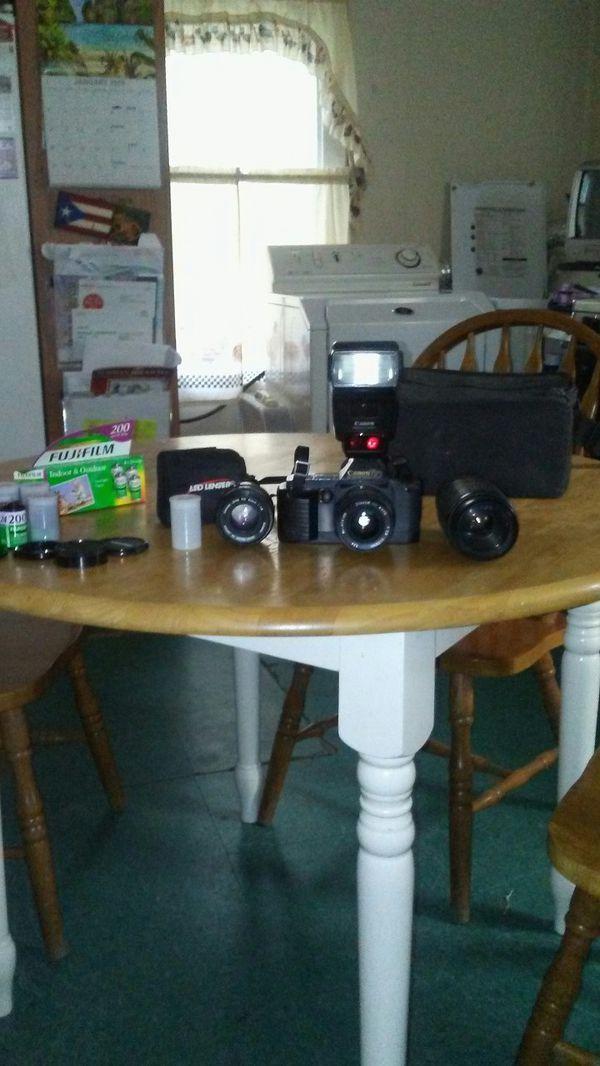 Canon T70 multiple program AV Dual metering system,Canon speedlite 420EX...by $125