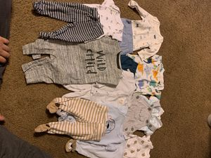 Newborn boy clothes and 27 size 1 diapers for Sale in Phoenix, AZ