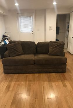 Lazy boy pull out queen sized bed couch with two pillows for Sale in San Francisco,  CA
